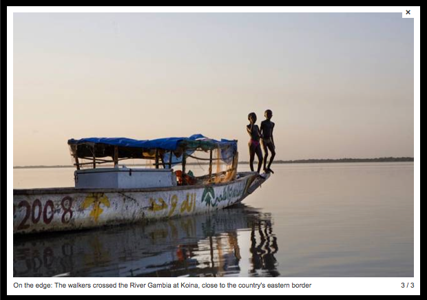 Boys playing on a boat on the River Gambia, Tendaba, The Gambia, West Africa