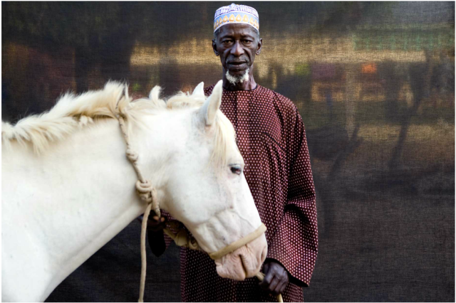 Herouna Tonkara with his white horse, The Gambia, West Africa