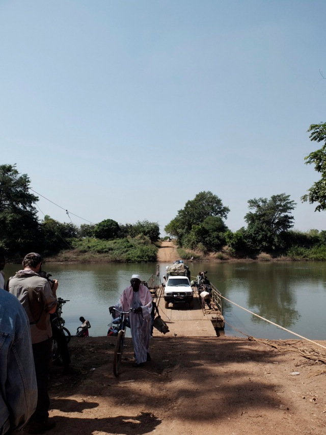 On route to Labe, Guinea - Florio films our ferry crossing over the River Gambia © Helen Jones-Florio