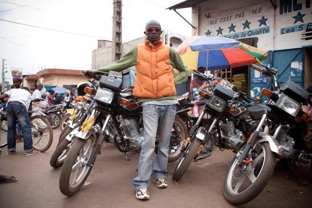 'Moto' boys, Labe. Guinea © Helen Jones-Florio