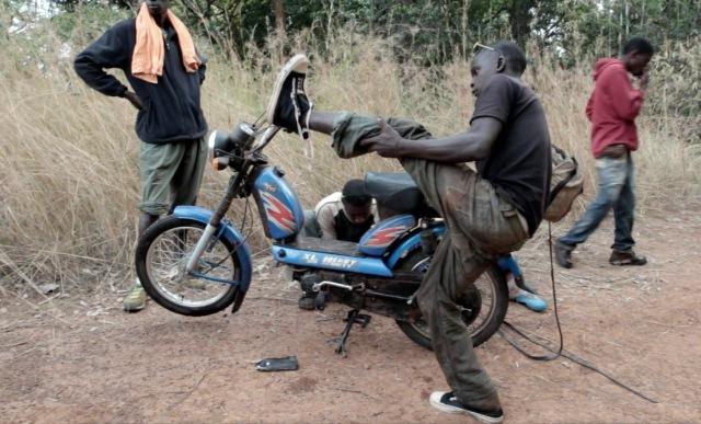 moto fixing-biker